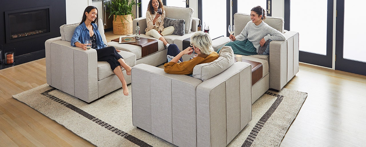 Group of friends enjoying some wine, while relaxing in a Lovesac Sactional.