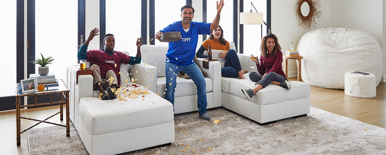 Group of friends enjoying some drinks and chips, worry free in their washable Lovesac Sactional.