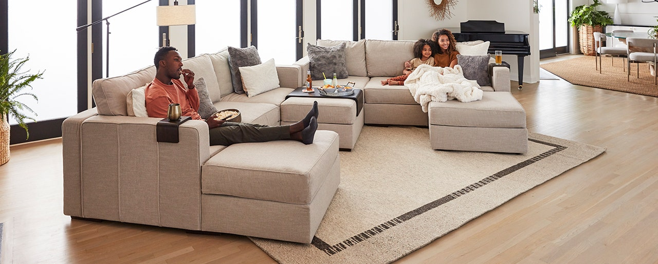 Family relaxing in their Lovesac Sactional.