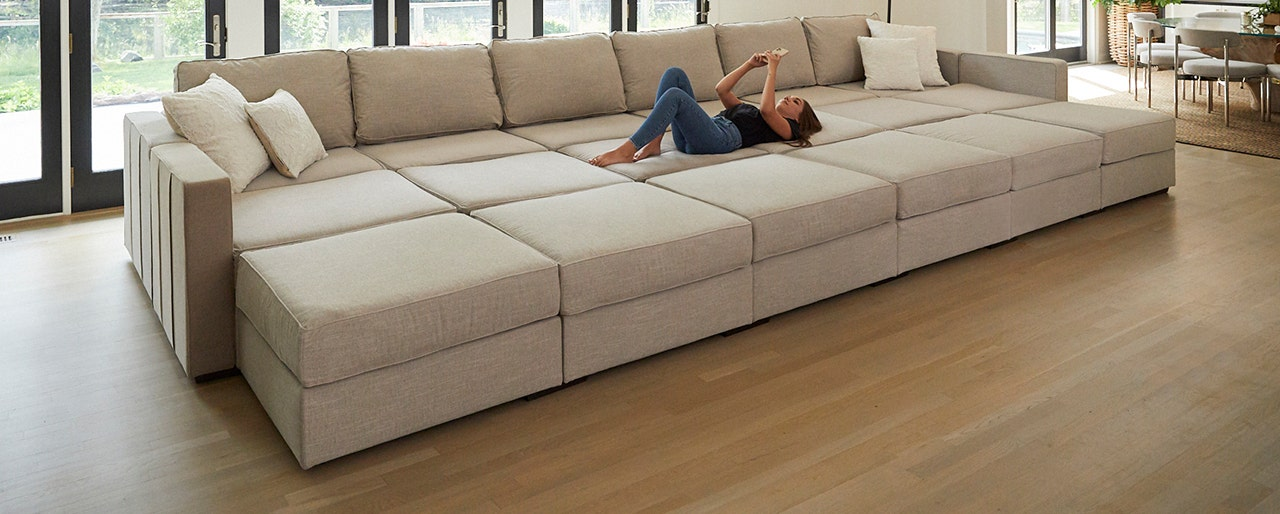 Woman relaxing in a huge Lovesac Sactional configuration.