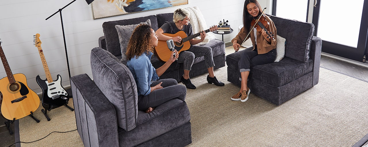 Group of friends relaxing in living room.