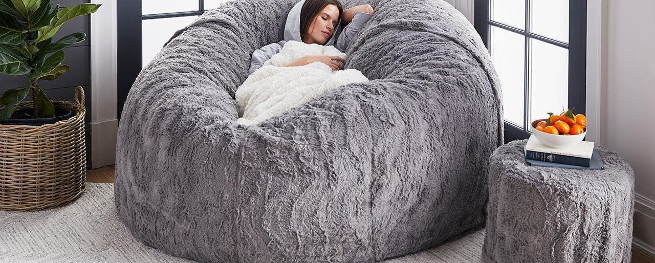 Woman napping on a comfortable sac/ bean bag.