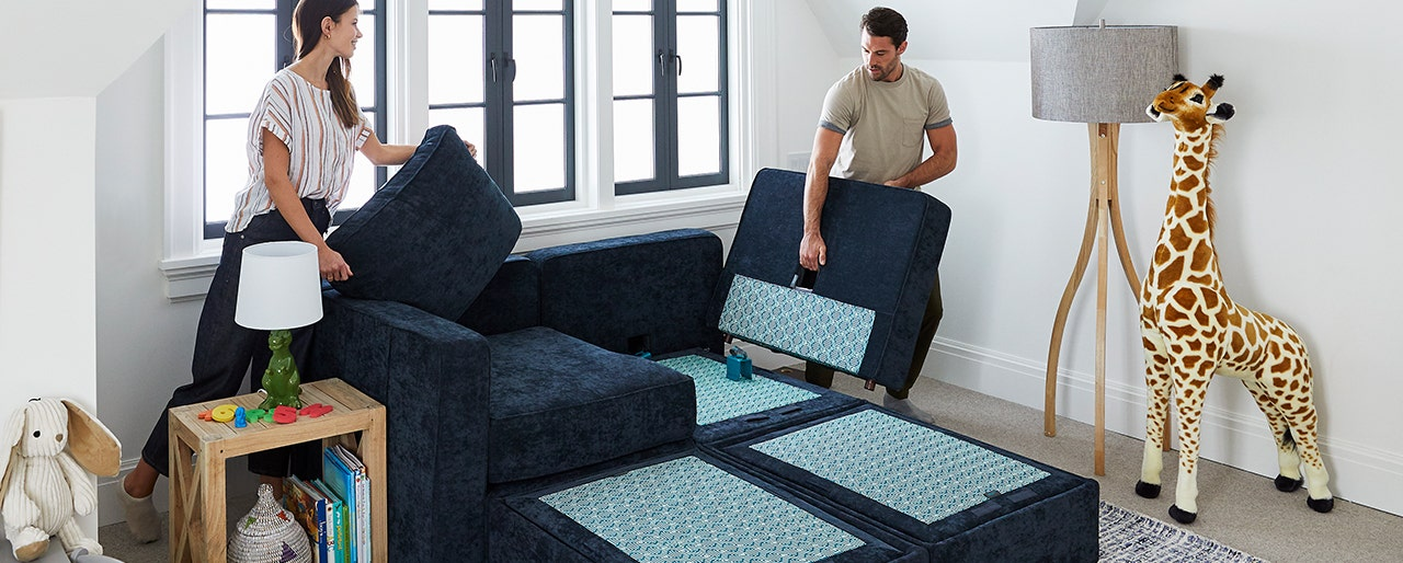 Man and woman rearranging sectional configuration.