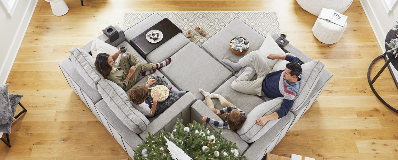 A family sitting together on their Lovesac Sactionals couch