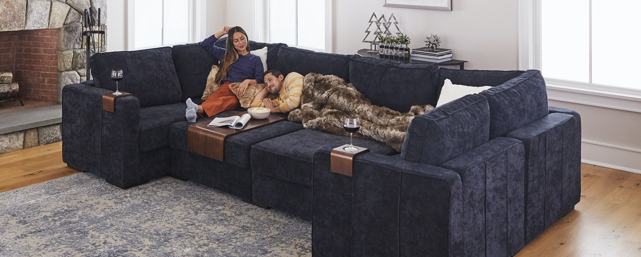 A couple relaxing on a Sactionals Couch