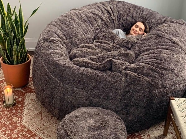 Woman cuddled-up on a beanbag