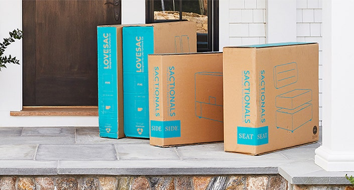 Four Sactionals boxes outside of a front door