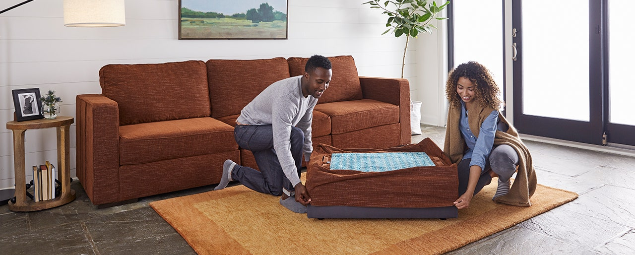 Couple changing the cover of the Lovesac Sactional seat.