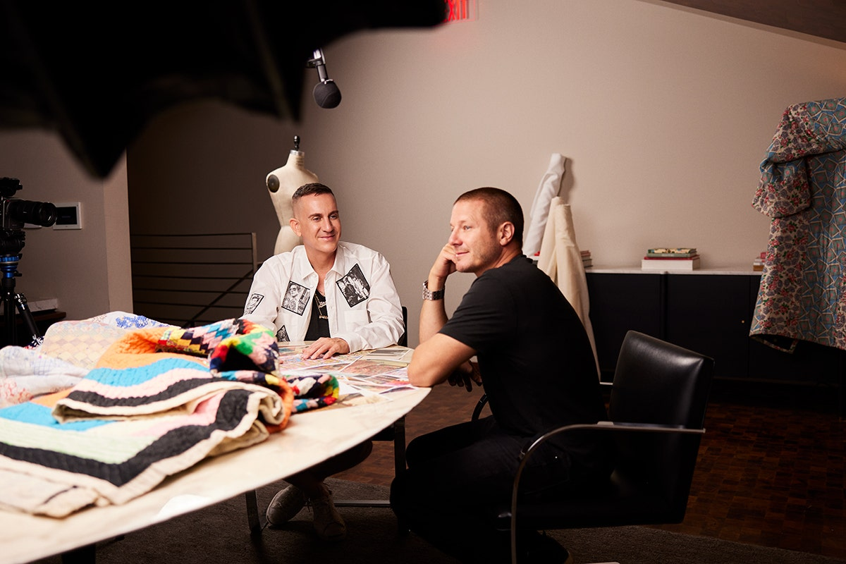 Jeremy Scott and Shawn Nelson talking during a photoshoot.
