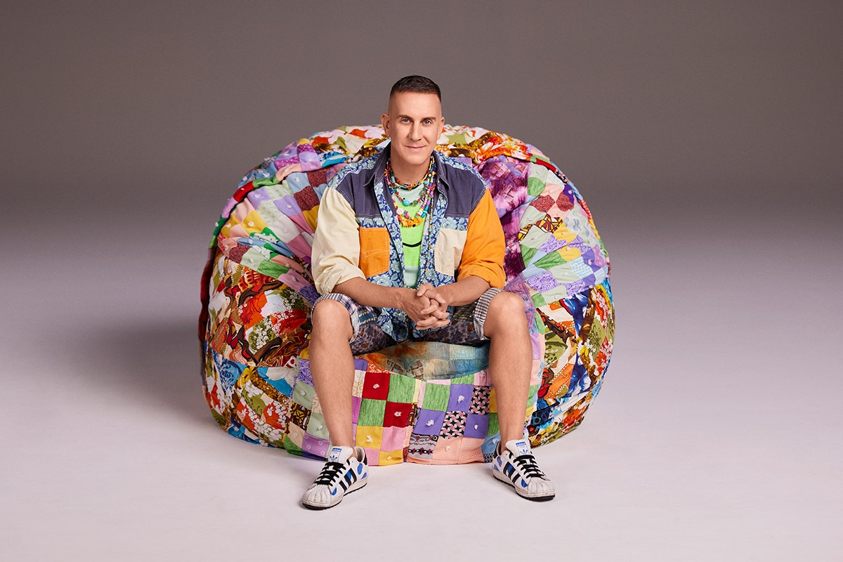 Jeremy Scott sitting in a limited edition SuperSac.
