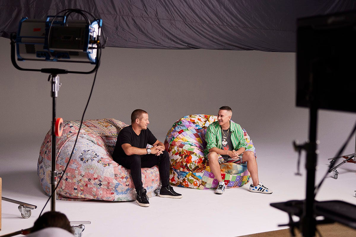 Shawn Nelson and Jeremy Scott sitting on SuperSacs during a photoshoot.