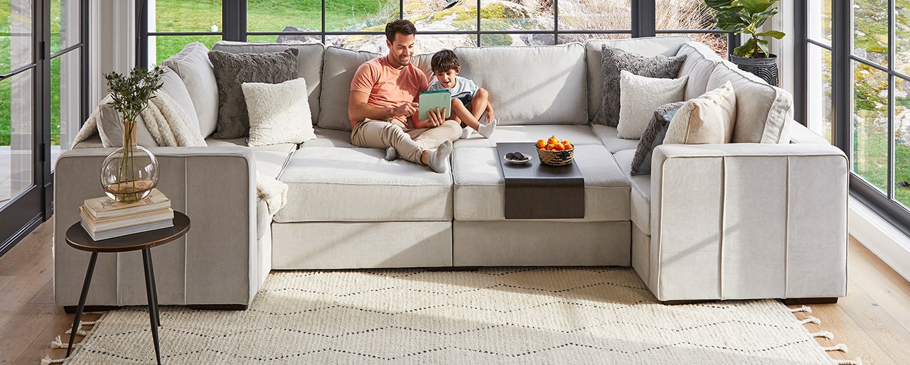 Dad and son relaxing in Lovesac Sactional.