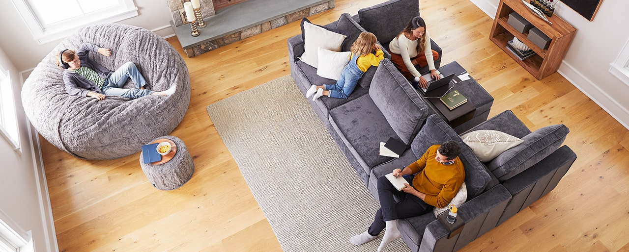 A family sitting together on their Lovesac Sactionals couch and Sac