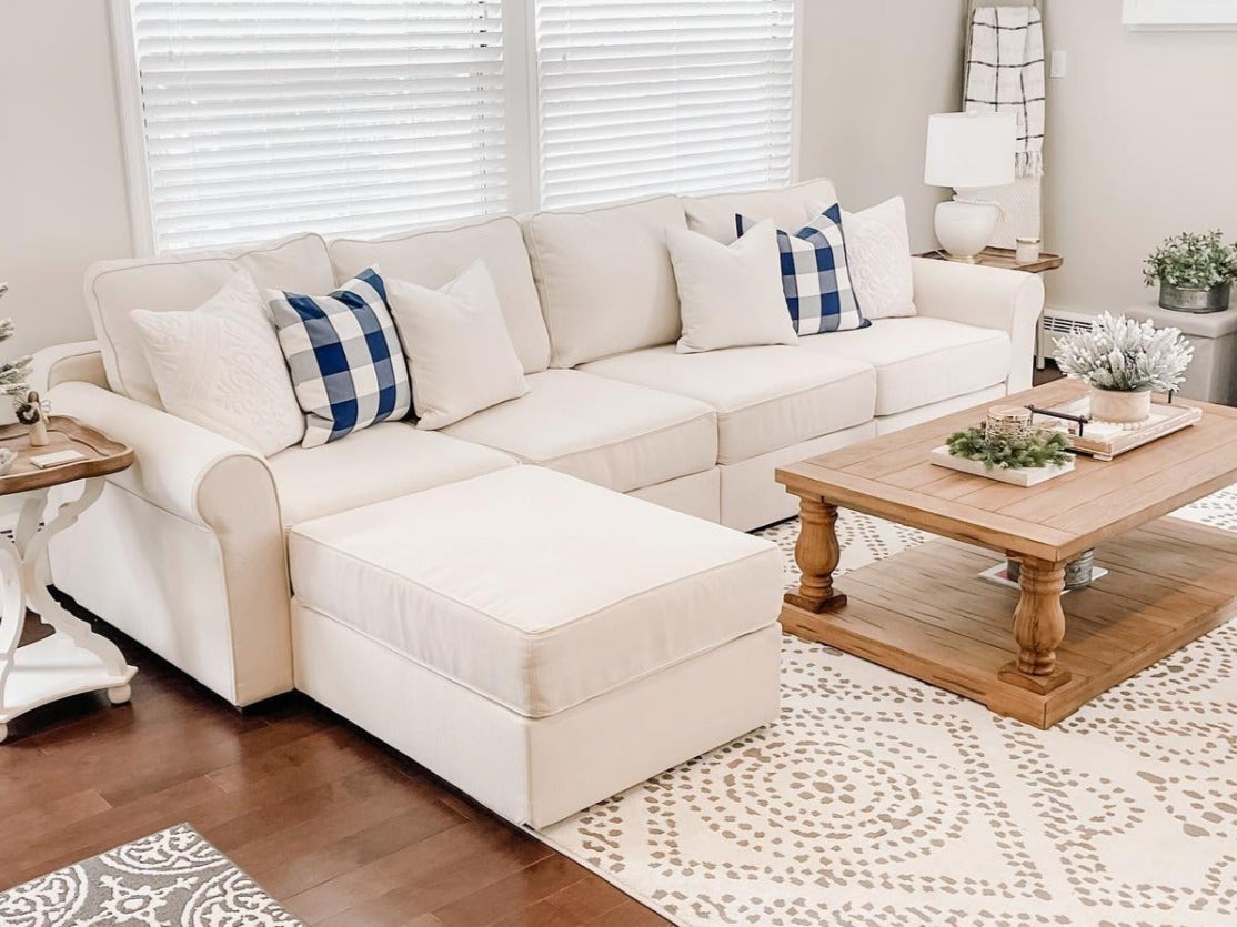 A white sactional / sectional couch