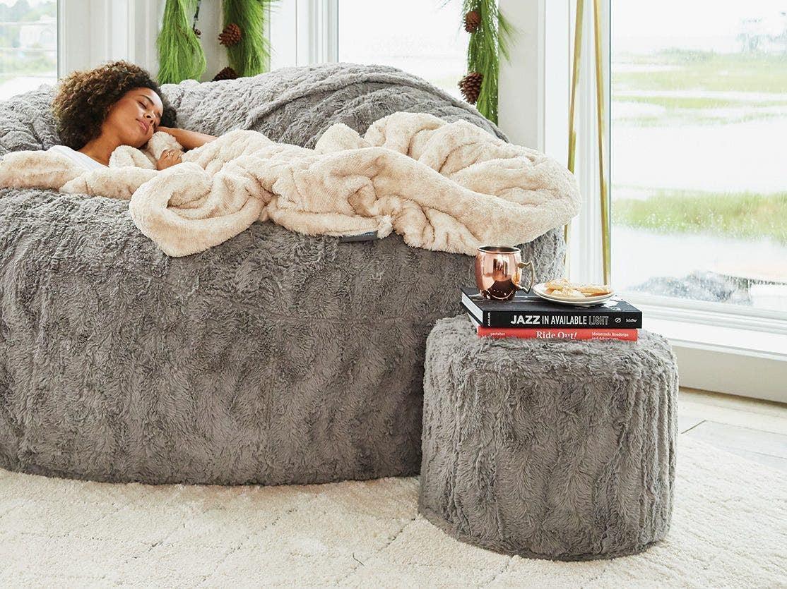 Woman napping on a sac/ beanbag.