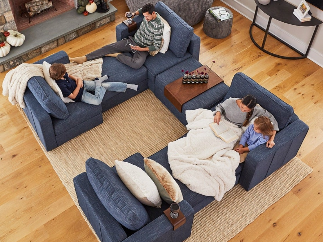 A family sitting in their sactional couch