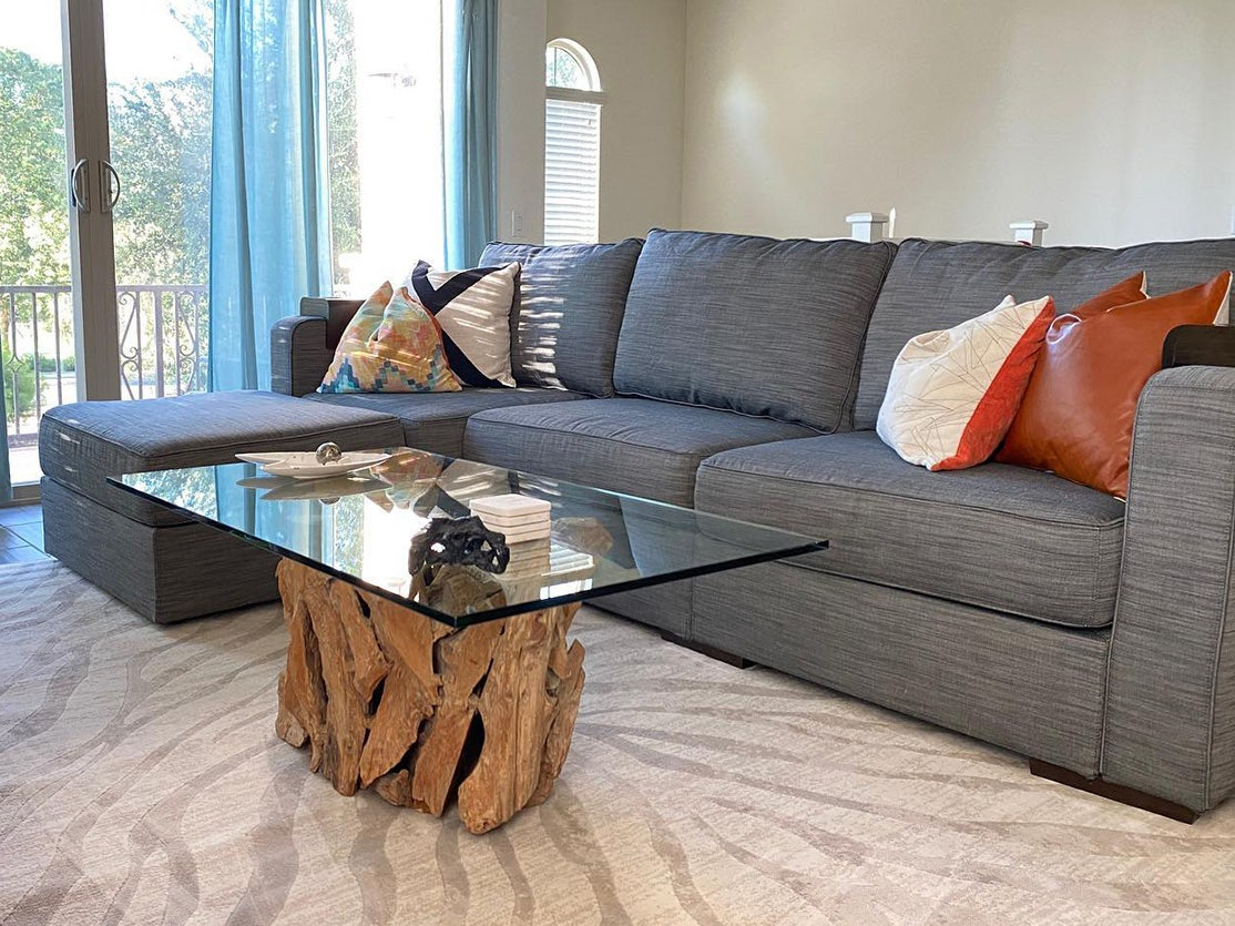 A living room with a Sactionals couch and a decorative coffee table