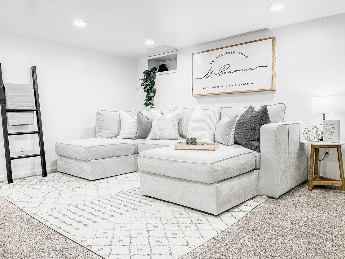 A light grey Sactionals couch set-up in a living room.