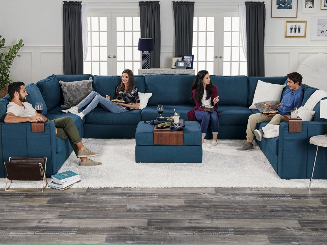 A family of four relaxing on their large Sactionals couch
